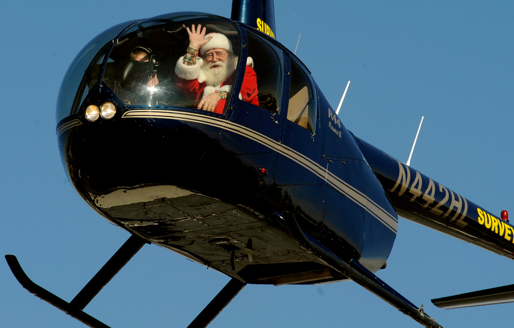 Description of . Santa arrives for a visit to Lupita's Restaurant in Aurora, CO, Saturday December 18, 2010. Santa Claus was flown to the restaurant in a helicopter, by Rotors of the Rockies for the 5th year. Owner Betty Oxley has been throwing a Christmas celebration for area children for 16 years. She says it started with Santa coming and sitting on the floor with children and has grown considerably over the years. She said,