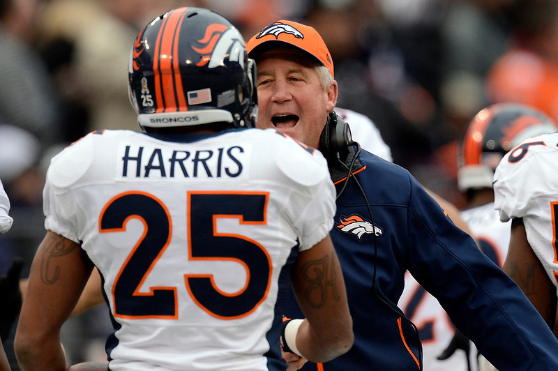 . Denver Broncos cornerback Chris Harris #25  and head coach John Fox after his run back of an interception for a touchdown at the M&T Bank Stadium, in Baltimore, MD Sunday December 16, 2012.      Joe Amon, The Denver Post