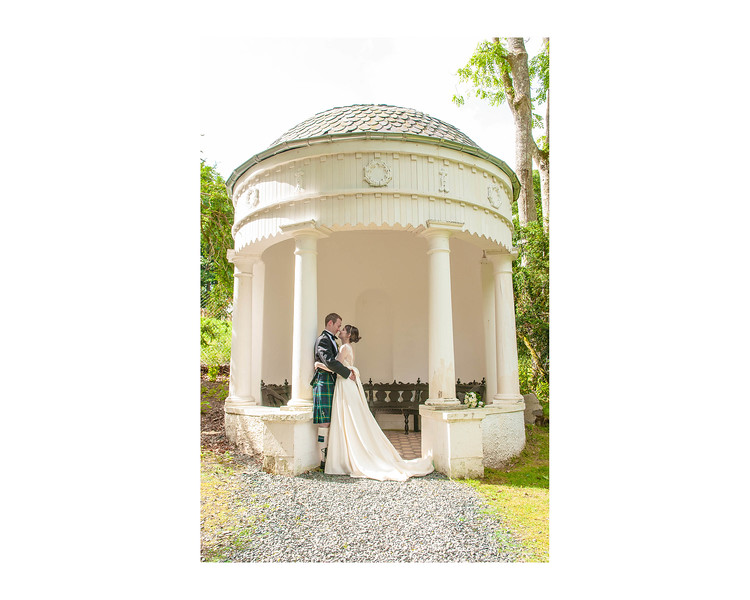 Wedding Photography of Susan & Ross, Barony Castle, Peebles, Scotland, Photograph is of the Bride & Groom standing in the entrance to a sun shelter