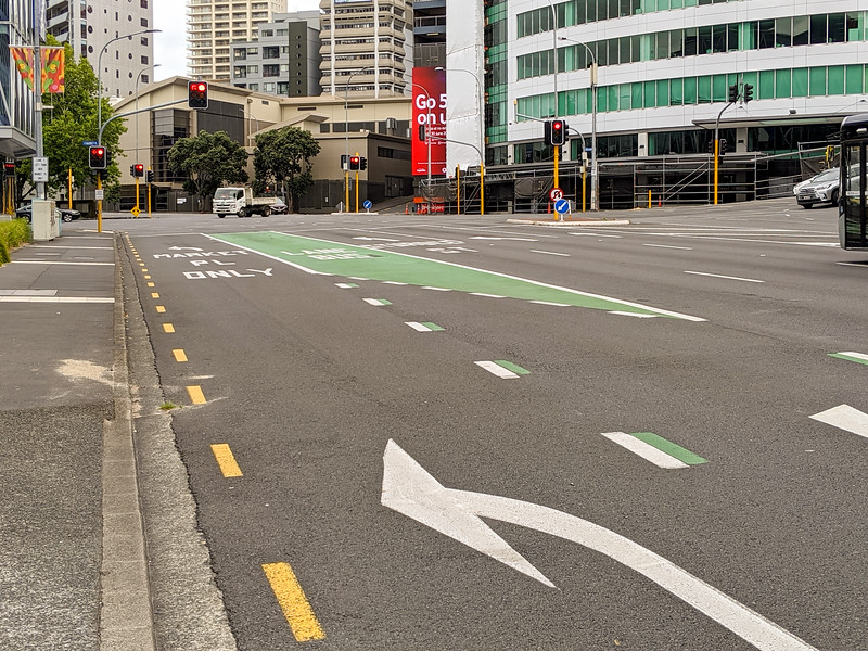 Green bus lane. This is common to have a turn lane, then the bus lane, then 'straight' lanes.