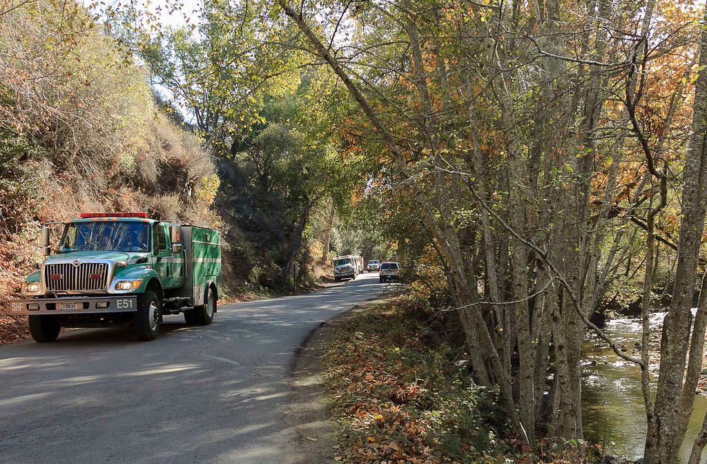 . With the Big Sur fire 100 percent contained, an USDA Forest Service truck, on a road in Pfeiffer Big Sur State Park, makes its way towards Highway 1, Saturday, December 21, 2013 in Big Sur, Calif. (Vernon McKnight/Herald Correspondent)