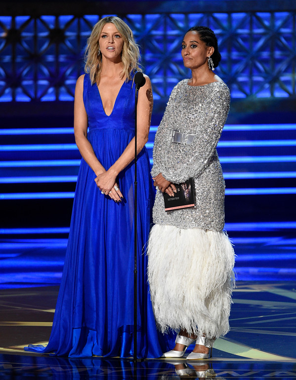 . Kaitlin Olson, left, and Tracee Ellis Ross present the award for outstanding writing for a variety series at the 69th Primetime Emmy Awards on Sunday, Sept. 17, 2017, at the Microsoft Theater in Los Angeles. (Photo by Chris Pizzello/Invision/AP)