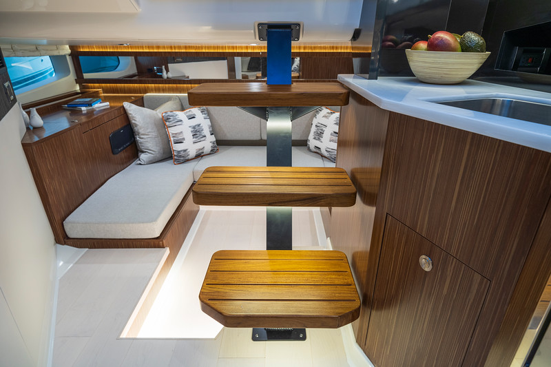2021-Sundancer-370-Outboard-DAO370-mid-berth-seating-galley-05048.jpg