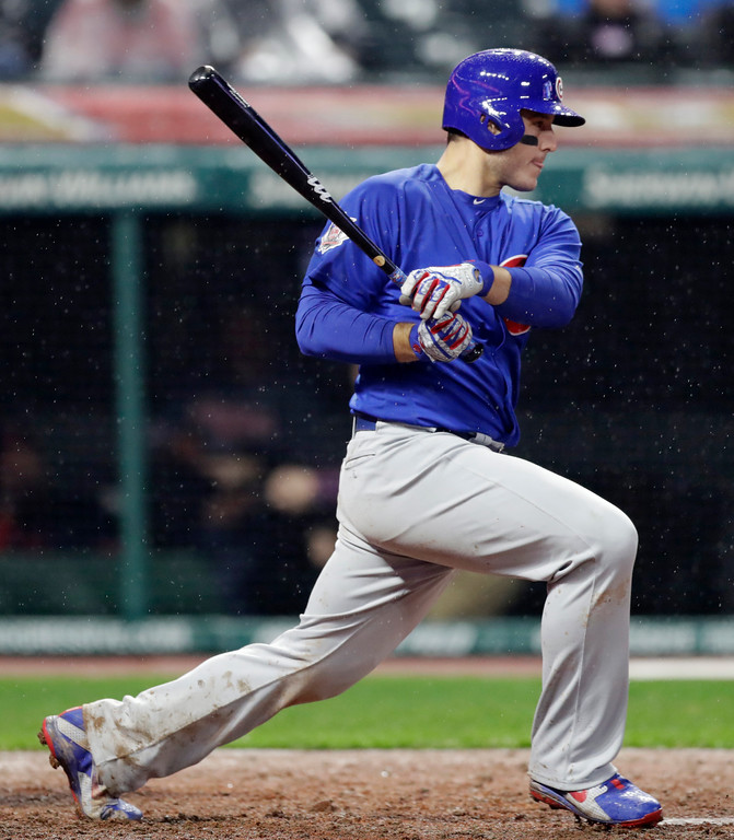 . Chicago Cubs\' Anthony Rizzo hits an RBI-single off Cleveland Indians relief pitcher Matt Belisle in the ninth inning of a baseball game, Tuesday, April 24, 2018, in Cleveland. Javier Baez scored on the play. (AP Photo/Tony Dejak)