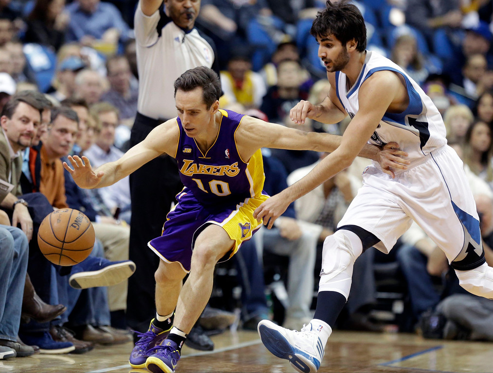 . Minnesota Timberwolves\' Ricky Rubio of Spain, right, knocks the ball away from Los Angeles Lakers\' Steve Nash in the first quarter of an NBA basketball game Wednesday, March 27, 2013 in Minneapolis. Rubio was charged with a foul on the play. (AP Photo/Jim Mone)