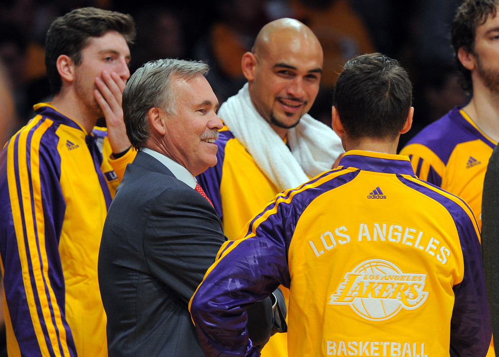 . Lakers coach Mike D\'Antoni celebrates with his players late in the 4th qtr in the NBA season opener between the Lakers and Clippers at Staples Center in Los Angeles, CA on Tuesday, October 29, 2013.  Lakers won 116-103. (Photo by Scott Varley, Daily Breeze)