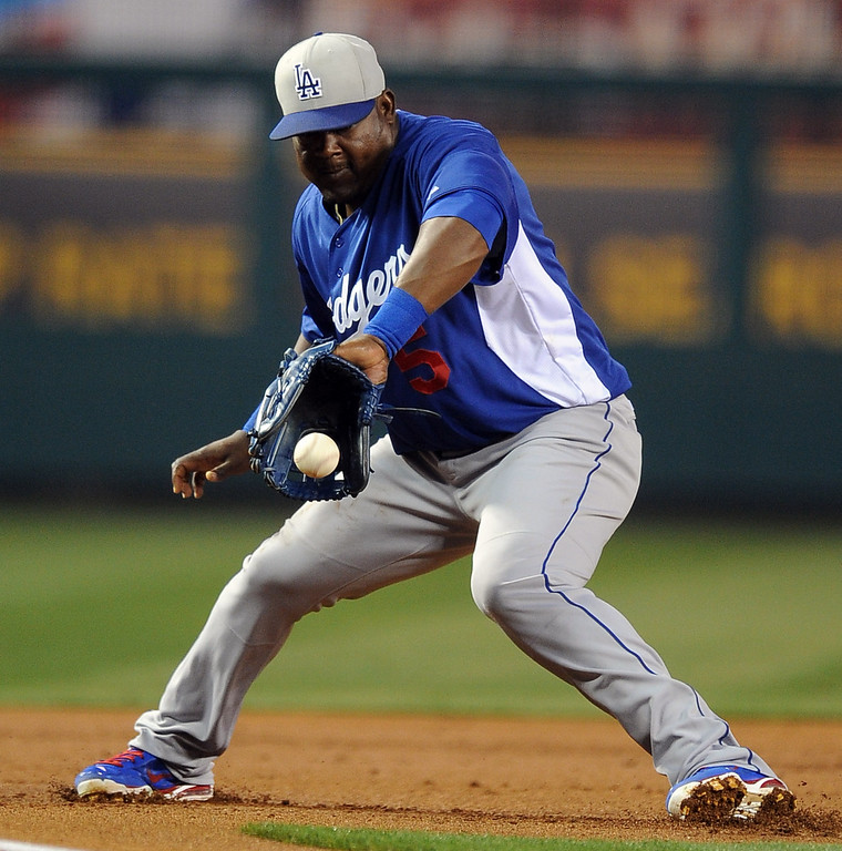 . Los Angeles Dodgers third baseman Juan Uribe fields a ground ball and throws out Los Angeles Angels\' Erick Aybar (not pictured) in the first inning of a spring baseball game on Thursday, March 28, 2012 in Anaheim, Calif.   (Keith Birmingham/Pasadena Star-News)