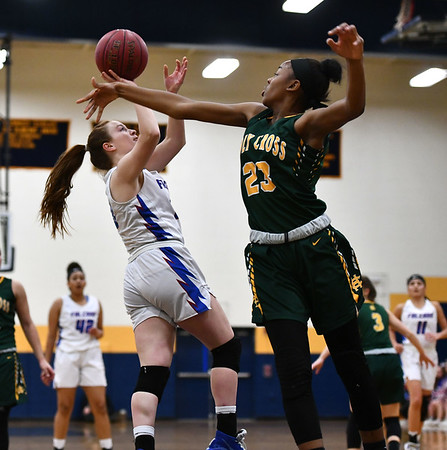 2/26/2020 Mike Orazzi | StaffrSt. Paul Catholic High School's Sophia Gerst r(10) and Holy Cross' Cayla Howard (23) during Wednesday night's CCC girls basketball tournament at Kennedy High School in Waterbury. rr