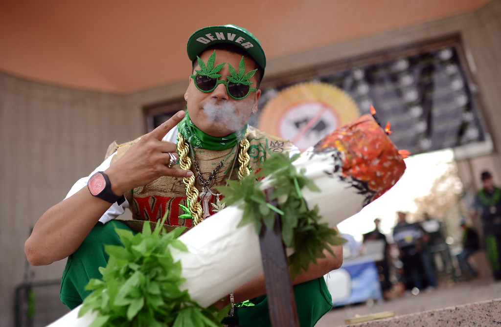 . DENVER, CO. - APRIL 20 : Rap musician Don Smoothiano celebrates 4/20 at the stage of Civic Center Park in Denver. A crowd of marijuana smokers gathered at the park to mark the counterculture holiday known as 4/20 on the first celebration since Colorado and Washington made pot legal for recreation use. (Photo By Hyoung Chang/The Denver Post)