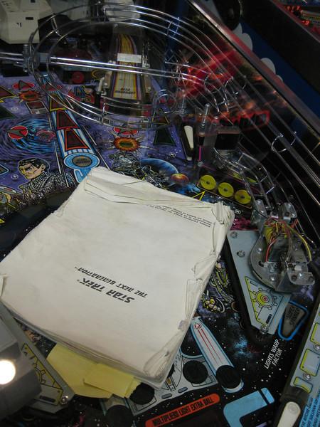 Star Trek: the Next Generation pinball manual on playfield.