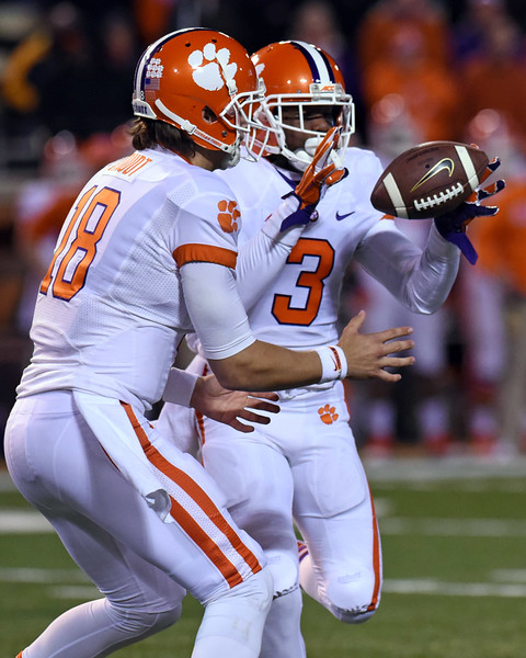 Cole Stoudt handoff to Artavis Scott.jpg