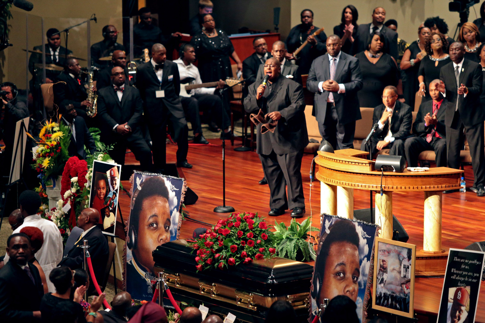 Description of . People attend the funeral of Michael Brown inside Friendly Temple Missionary Baptist Church on August 25, 2014 in St. Louis Missouri. Michael Brown, an 18 year-old unarmed teenager, was shot and killed by Ferguson Police Officer Darren Wilson in the nearby town of Ferguson, Missouri on August 9. His death caused several days of violent protests along with rioting and looting in Ferguson.  (Photo by Robert Cohen-Pool/Getty Images)