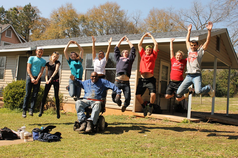 Thad Harris spends many hours supervising volunteer teams who come to work with the Americus-Sumter Fuller Center for Housing. Here, he has some fun with a group of students from The Ohio State University.