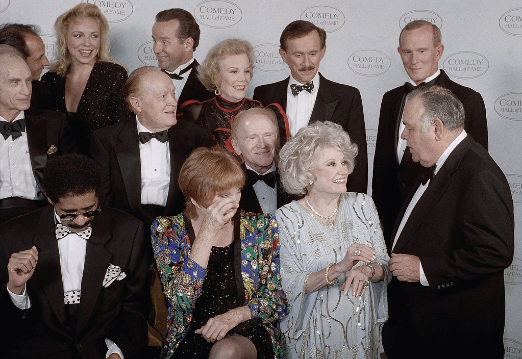 """. Jonathan Winters\' , right, middle row, droll humor draws guffaws from comedy greats waiting for a group photo at the taping of NBC\'s second annual \""""Comedy Hall of Fame\"""" shown on Sunday Aug. 29, 1994 in Beverly Hills, California. Left to right, front are Shirley Maclaine and Phyllis Diller; middle, Bob Hope, Nanette Fabray, Red Buttons; rear, Phil Hartman, Dick and Tom Smother. Honored for their lifetime achievement were Hope, Maclaine, and Sid Caesar, Mary Tyler Moore (not shown), George Carlin (not shown) and Richard Pryor. (AP Photo/Reed Saxon)"""