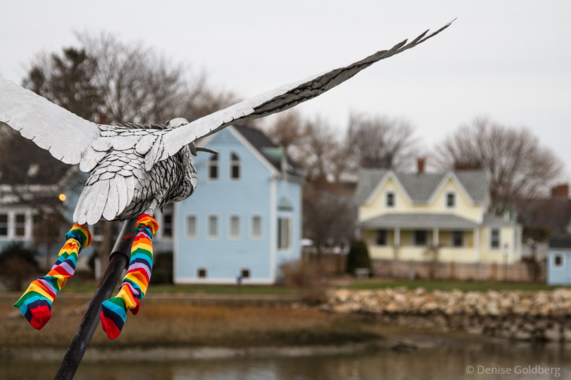 sculpture of a great blue heron, dressed for winter