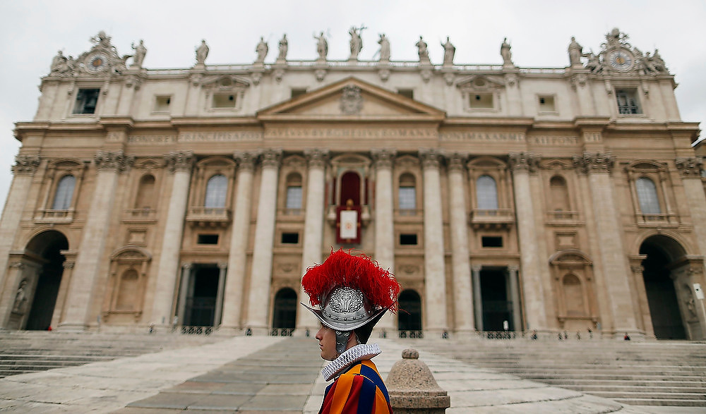 Description of . A Swiss guard stands before Pope Benedict XVI arrives for his