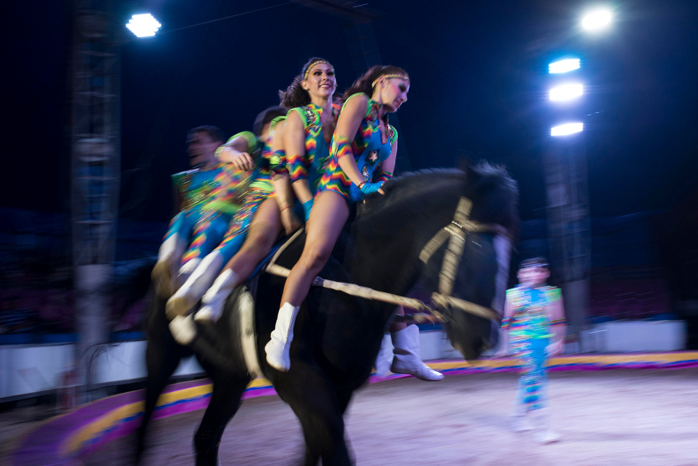 . In this June 22, 2014 photo, circus performers ride a horse during one of their routines with the Fuentes Gasca Brothers Circus in Mexico City. Recent legislation in the city will ban animals from the circus once the law takes effect next year. The law promises steep fines for noncompliance. (AP Photo/Sean Havey)