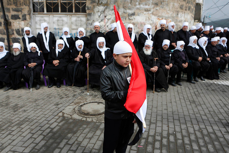 . A boy from the Druze community holds a Syrian flag during a rally marking Syria\'s Independence Day in the Druze village of Buqata on the Golan Heights April 17, 2013. Israel captured the Golan Heights from Syria in the 1967 Middle East war and annexed the territory in 1981, a move not recognized internationally. REUTERS/Baz Ratner