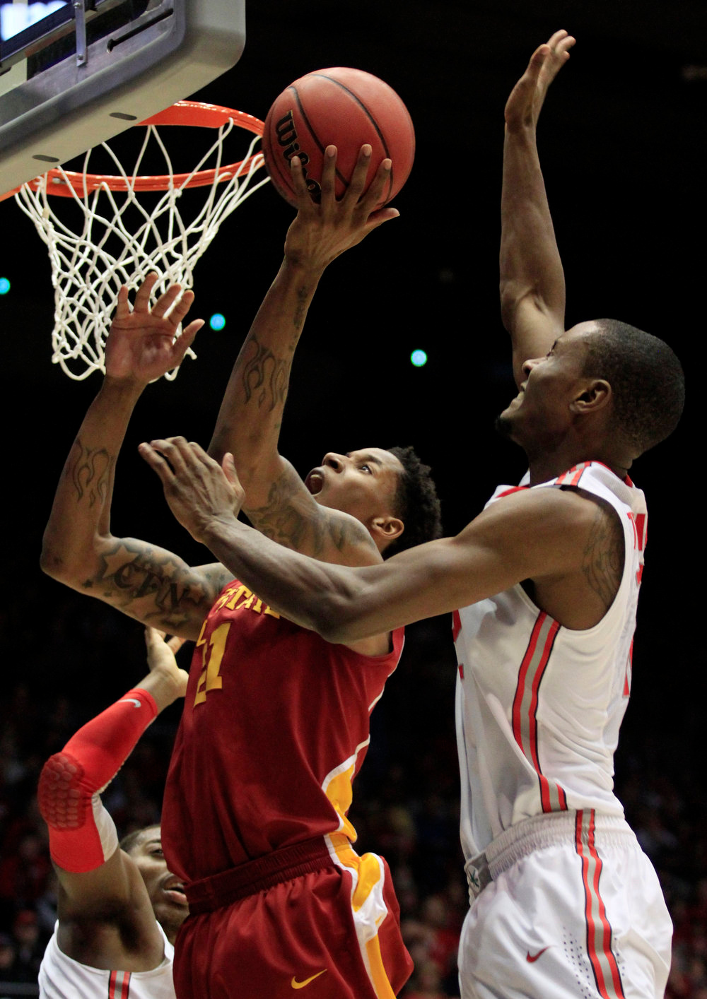 . Iowa State guard Will Clyburn, left, shoots against Ohio State forward Sam Thompson in the second half of a third-round game of the NCAA college basketball tournament, Sunday, March 24, 2013, in Dayton, Ohio. (AP Photo/Skip Peterson)