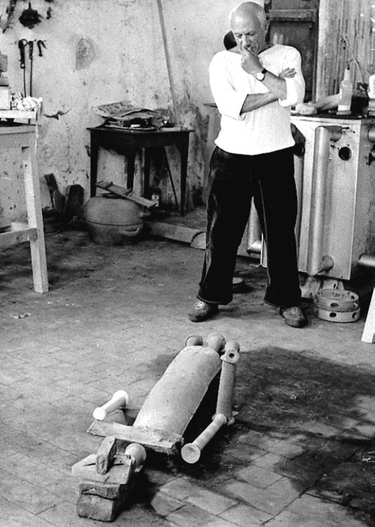 . Artist Pablo Picasso studies the figure of a woman he assembled on the floor of his studio at Vallauris, southern France, Oct. 26, 1953. Picasso used tiles, bricks and branches with leaves as raw materials. (AP Photo)