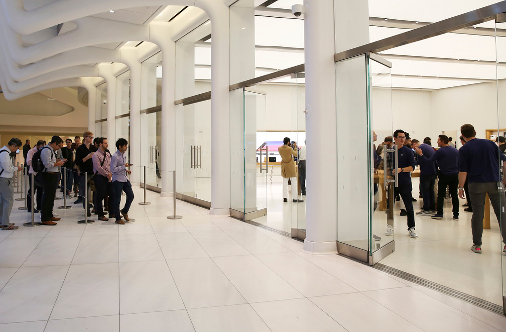 . Customers wait in line outside of the Apple Store at World Trade Center to purchase the iPhone X, Friday, Nov. 3, 2017, in New York. (AP Photo/Steve Luciano)