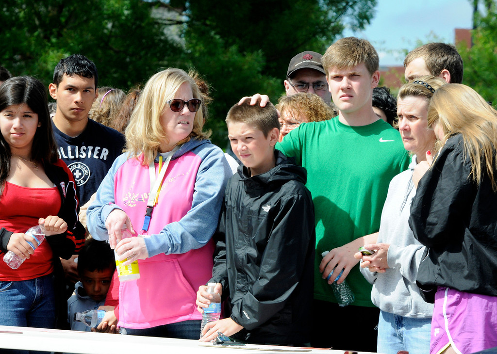 . Families wait at the Fred Meyer grocery store parking lot in Wood Village, Ore., to be reunited with students after a shooting at Reynolds High School Tuesday, June 10, 2014, in nearby Troutdale. (AP Photo/Greg Wahl-Stephens)
