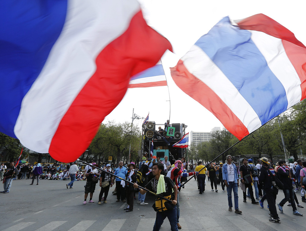 . Thai anti-government protesters wave national flags during a rally near Government House in Bangkok, Thailand, 18 February 2014.  EPA/NARONG SANGNAK