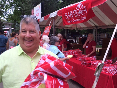 Photos from the beach towel giveway at the Saratoga Race Course