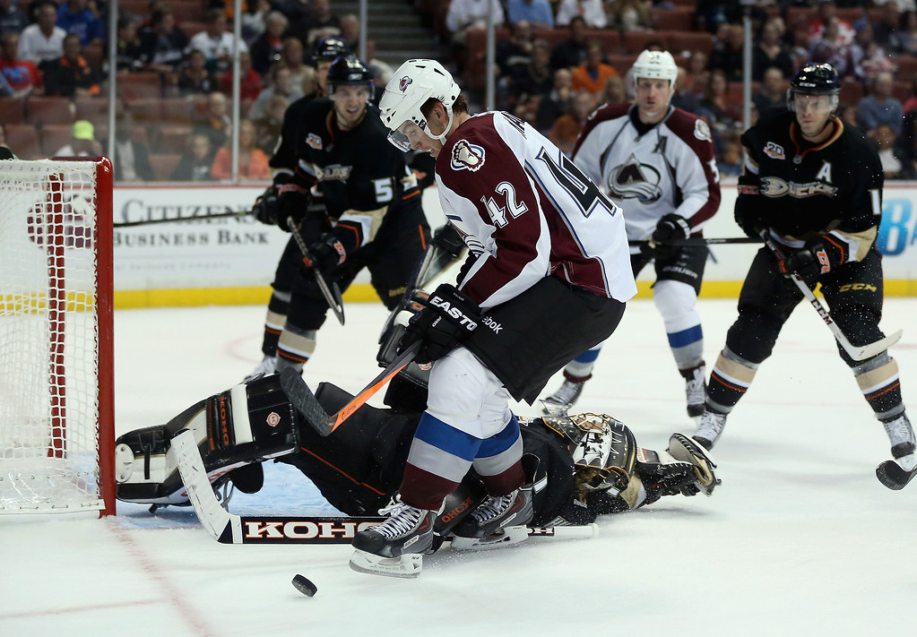 . Brad Malone #42 of the Colorado Avalanche tries to control the puck, as  goaltender Jonas Hiller #1 of the Anaheim Ducks sprawls on his back in the second period at Honda Center on September 22, 2013 in Anaheim, California.  (Photo by Jeff Gross/Getty Images)