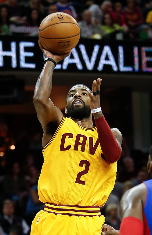 . Cleveland Cavaliers\' Kyrie Irving (2) shoots against the Detroit Pistons during the first half of an NBA basketball game Friday, Nov. 18, 2016, in Cleveland. The Cavaliers won 104-81. (AP Photo/Ron Schwane)