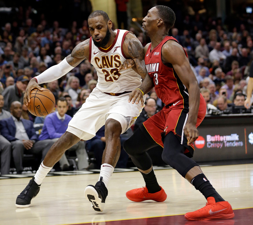 . Cleveland Cavaliers\' LeBron James (23) drives against Miami Heat\'s Bam Adebayo (13) in the first half of an NBA basketball game, Tuesday, Nov. 28, 2017, in Cleveland. (AP Photo/Tony Dejak)
