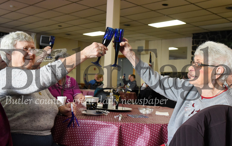 Harold Aughton/Butler Eagle: Sisters, Carol Shay Borarts, left, of Fennelton and Marlene Nagle of Butler recently made a toast to the New Year at Tanglewood Senior Center, Thursday, December 26, 2019.
