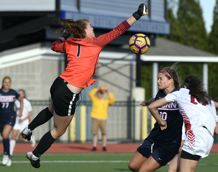 9/1/2017 Mike Orazzi | Staff UConn goalie Mollie Kerrigan (1) gives up a goal to St. John's Christine Bellero (17) during the CCSU Soccer Tournament in New Britain Friday evening.
