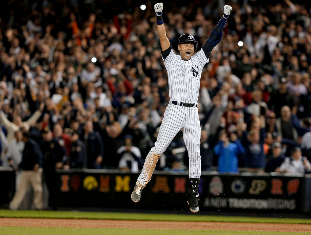 . New York Yankees\' Derek Jeter jumps after hitting the game-winning single against the Baltimore Orioles in the ninth inning of a baseball game, Thursday, Sept. 25, 2014, in New York. The Yankees won 6-5. (AP Photo/Julie Jacobson)