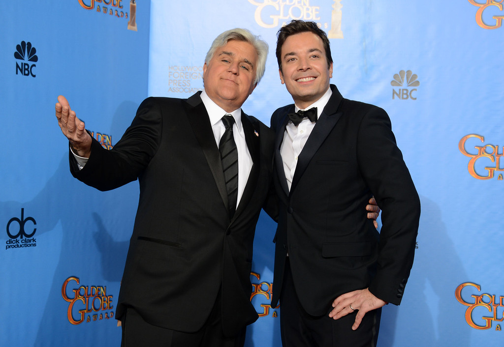 ". FILE - This Jan. 13, 2013 file photo shows Jay Leno, host of ""The Tonight Show with Jay Leno,\"" left, and Jimmy Fallon, host of \""Late Night with Jimmy Fallon\"" backstage at the 70th Annual Golden Globe Awards in Beverly Hills, Calif. On Thursday, Feb. 6, 2014, Leno, 63, is stepping down for the second and presumably last time, making way for his successor, Fallon, in New York. Fallon, 39, starts his \""Tonight Show\"" on Feb. 17, with NBC hoping he rides the promotional wave of its Winter Olympics coverage. (Photo by Jordan Strauss/Invision/AP, file)"