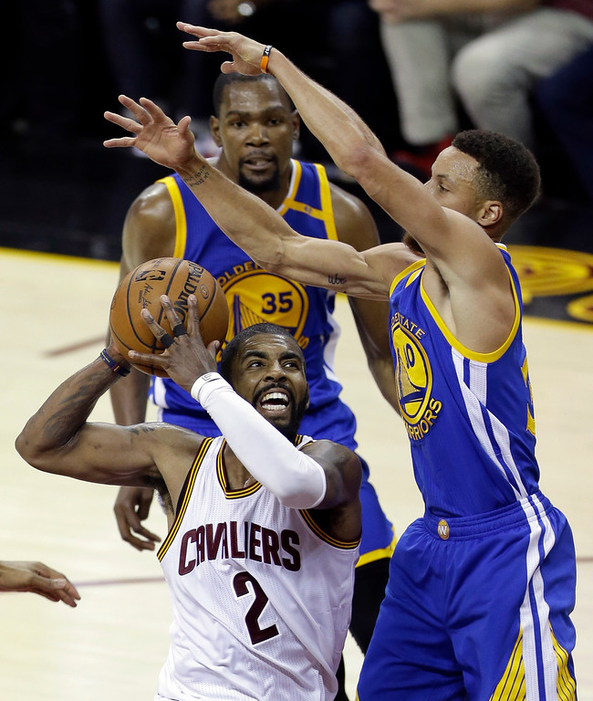 . Cleveland Cavaliers guard Kyrie Irving (2) drives on Golden State Warriors guard Stephen Curry, right, during the second half of Game 3 of basketball\'s NBA Finals in Cleveland, Wednesday, June 7, 2017. (AP Photo/Tony Dejak)