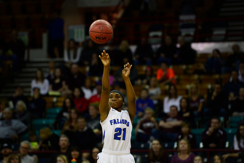 . Highlands Ranch point guard Symone Starks (21) goes up for a three during the first quarter at the Pepsi Center on March 4, 2016 in Denver, Colorado. Highlands Ranch defeated Horizon 65-35 to advance to the semifinals of girls 5A basketball tournament. (Photo by Brent Lewis/The Denver Post)