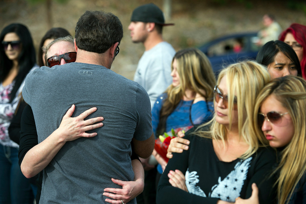 . Amie Kaz pays is comforted by her husband at a memorial for her half brother actor Paul Walker who was killed on Saturday, November 30, 2013 in Valencia, Ca. Walker was in a 2005 Porsche Carrera GT, believed to be driven by his friend Roger Rodas, that crashed and burst in to flames killing both occupants. (Photo by Hans Gutknecht/Los Angeles Daily News)