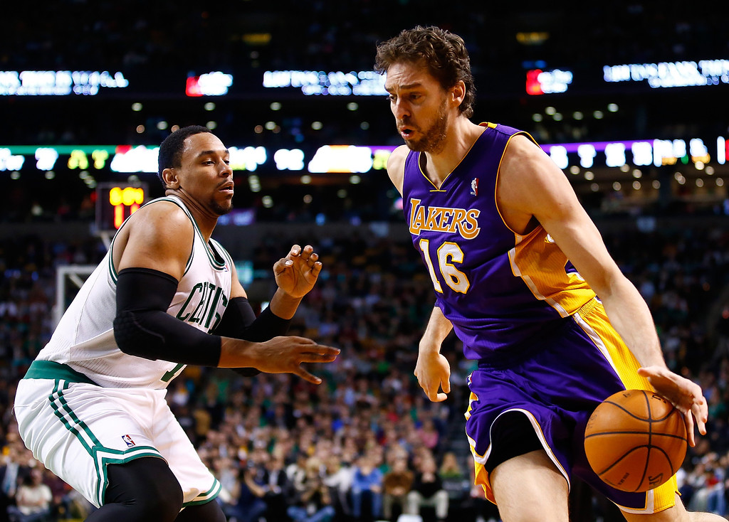 . BOSTON, MA - JANUARY 17: Pau Gasol #16 of the Los Angeles Lakers drives to the basket past Jared Sullinger #7 of the Boston Celtics in the second half during the game at TD Garden on January 17, 2014 in Boston, Massachusetts.   (Photo by Jared Wickerham/Getty Images)