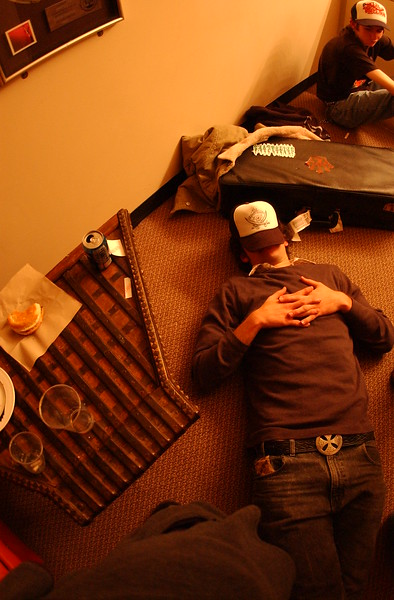 GUS RAMAGE formerly of THE SUPERVILLAINS takes a nap in preparation for their gig at The Hard Rock Live in Orlando, FL 01-18-2003