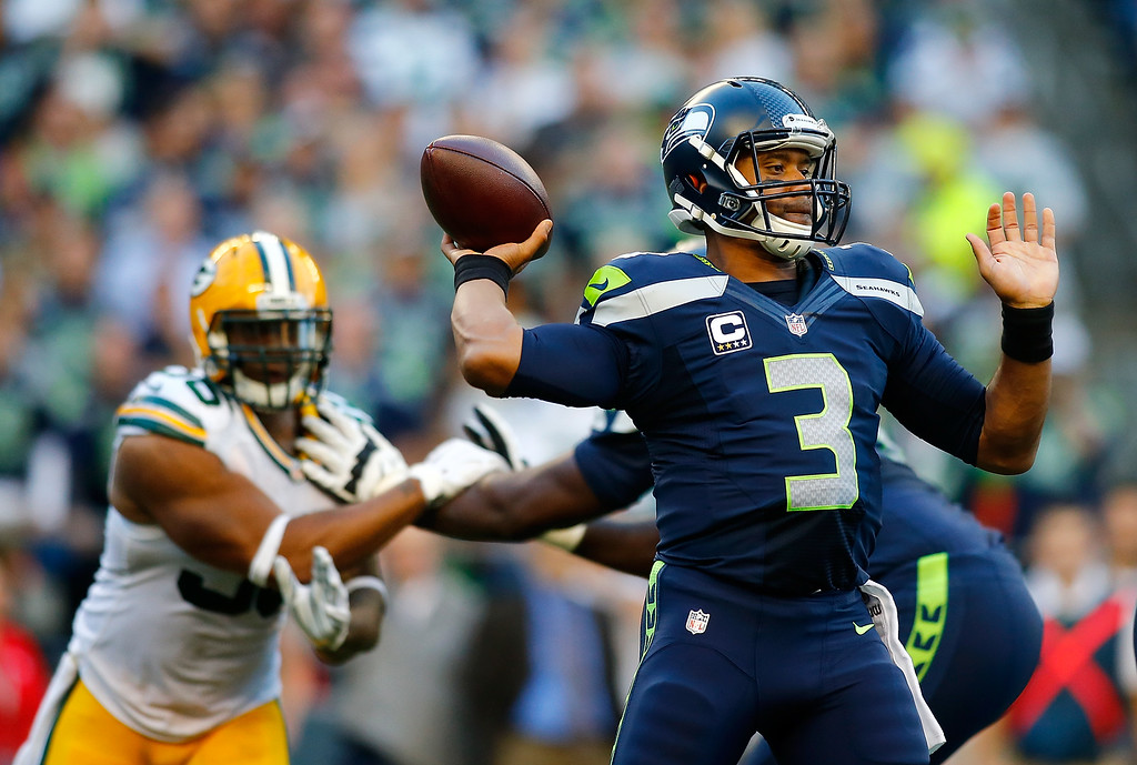 . SEATTLE - SEPTEMBER 04:  Quarterback Russell Wilson #3 of the Seattle Seahawks throws a pass against the Green Bay Packers at Century Link Field on September 4, 2014 in Seattle, Washington.  (Photo by Jonathan Ferrey/Getty Images)
