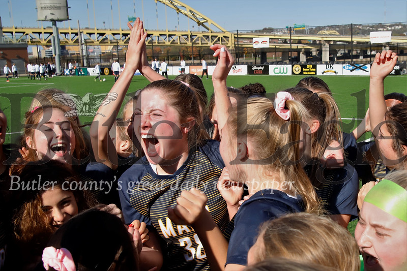 Mars girls celebrate the 2019 WPIAL Class 3A Championship following a 4-0 win over Plum at Highmark Stadium in Pittsburgh Saturday. Seb Foltz/Butler Eagle