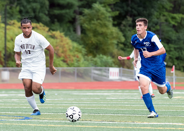 09/17/18 Wesley Bunnell | Staff Bristol Eastern soccer defeated New Britain 2-0 on Monday afternoon at Bristol Eastern High School. New Britain's Nolber Gonzalez (17) and Bristol Eastern's Ben Chiasson (17).