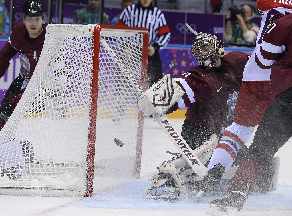 . Latvia\'s goalkeeper Edgars Masalskis reacts as the puck flies past his goal during the Men\'s Ice Hockey Group C match Czech Republic vs Latvia at the Bolshoy Arena during the Sochi Winter Olympics on February 14, 2014.    AFP PHOTO / JONATHAN NACKSTRAND/AFP/Getty Images