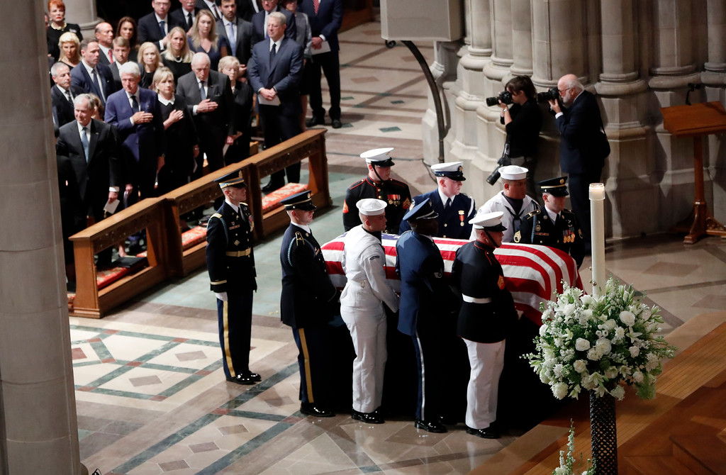 . From front row left, former President George W.  Bush, former first lady Laura Bush, former President Bill Clinton, former Secretary of State Hillary Clinton, former Vice President Dick Cheney and his wife Lynne and former Vice President Al Gore watch as the casket arrives for a memorial service for Sen. John McCain, R-Ariz., at Washington National Cathedral in Washington, Saturday, Sept. 1, 2018. McCain died Aug. 25, from brain cancer at age 81. (AP Photo/Pablo Martinez Monsivais)