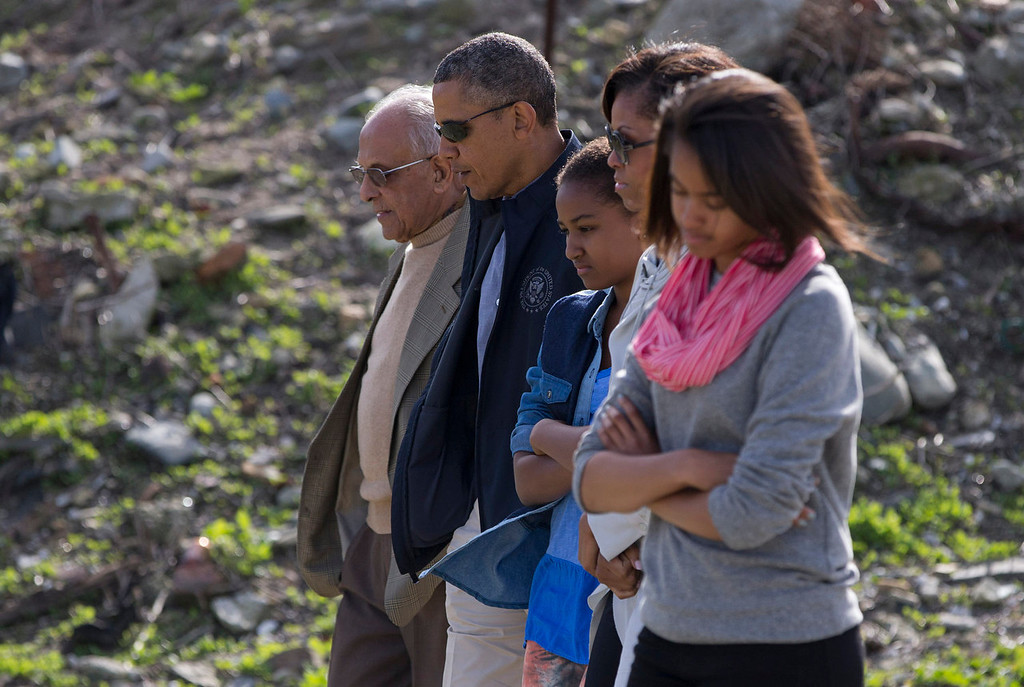 . U.S. President Barack Obama, second from left, and the first family tour a rock quarry where Robben Island prisoners once worked near Cape Town, South Africa, Sunday, June 30, 2013. Robben Island is an historic Apartheid-era prison that held black political prisoners including former South African president and anti-apartheid hero Nelson Mandela. From left, tour guide Ahmed Kathrada, Obama, daughter Sasha, first lady Michelle Obama, and daughter Malia. (AP Photo/Evan Vucci)