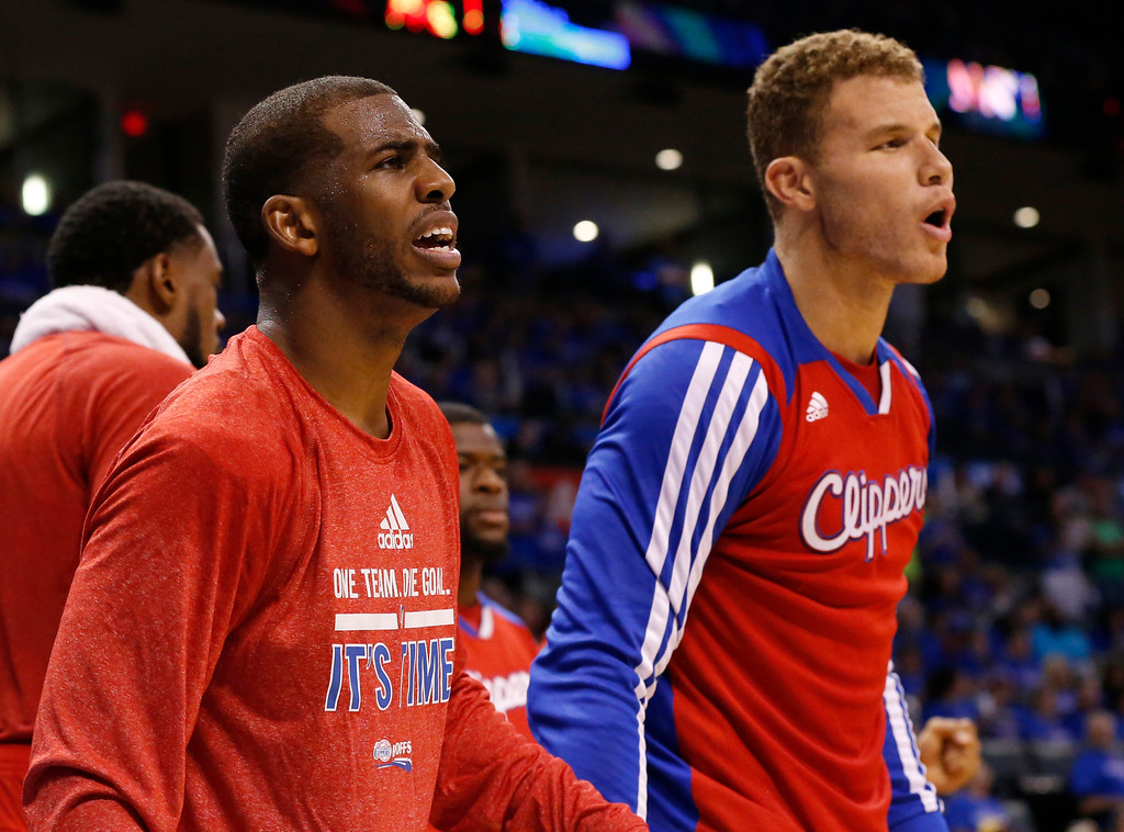 . Los Angeles Clippers guard Chris Paul, left, and forward Blake Griffin, right, shout to their teammates in the fourth quarter of Game 1 of the Western Conference semifinal NBA basketball playoff series against the Oklahoma City Thunder in Oklahoma City, Monday, May 5, 2014. Los Angeles won 122-105. (AP Photo/Sue Ogrocki)