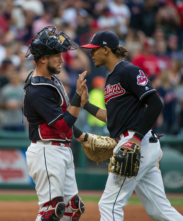 . Cleveland Indians\' Yan Gomes greets Erik Gonzalez after the Indians 8-4 win over the Kansas City Royals after a baseball game in Cleveland, Saturday, Sept. 16, 2017. (AP Photo/Phil Long)