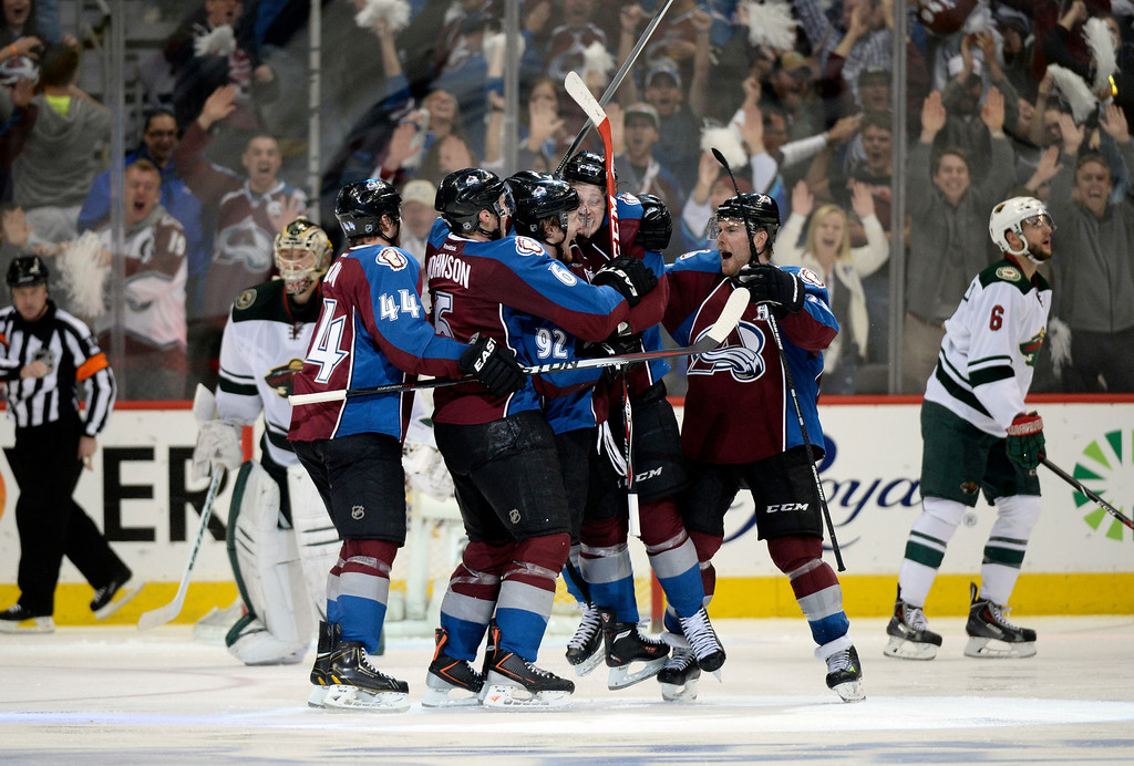 . DENVER, CO - APRIL 26: The Colorado Avalanche celebrate a game winning goal by Colorado Avalanche center Nathan MacKinnon (29) in overtime. The Avalanche defeated the Wild 4 to 3.  The Colorado Avalanche hosted the Minnesota Wild in the fifth round of the Stanley Cup Playoffs at the Pepsi Center in Denver, Colorado on Saturday, April 26, 2014. (Photo by John Leyba/The Denver Post)
