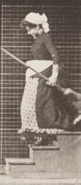 Woman descending stairs, turning and carrying a bucket of water and a broom